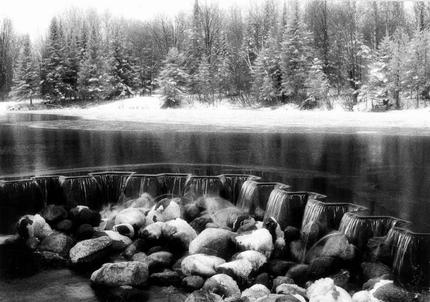 Winter at the dam at Rugg Pond.  Rugg was also known as Mossback, a nickname for one of the original inhabitants of the town. <BR><BR>  It is rumored that Hemmingway spent the night fishing at this location. -