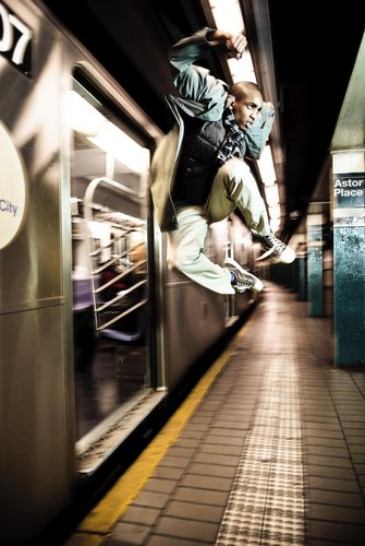 Beauty in Motion - 'How did you get an empty subway?!'  That's what everyone wants to know.  Simple answer; you run in, you jump and the photographer takes the picture.  We did it in two takes and one train.  Professional; that's how pros do it. (Harry Poicus)