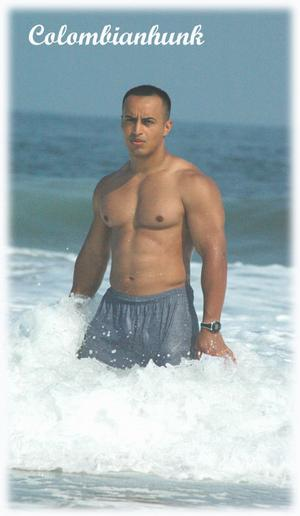 In the wave Colombian hunk at the beach