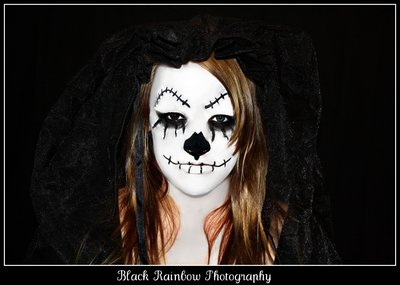 Dia de los Muertos Beautiful young woman with face painted as dia de los muertos skull wearing a black veil
