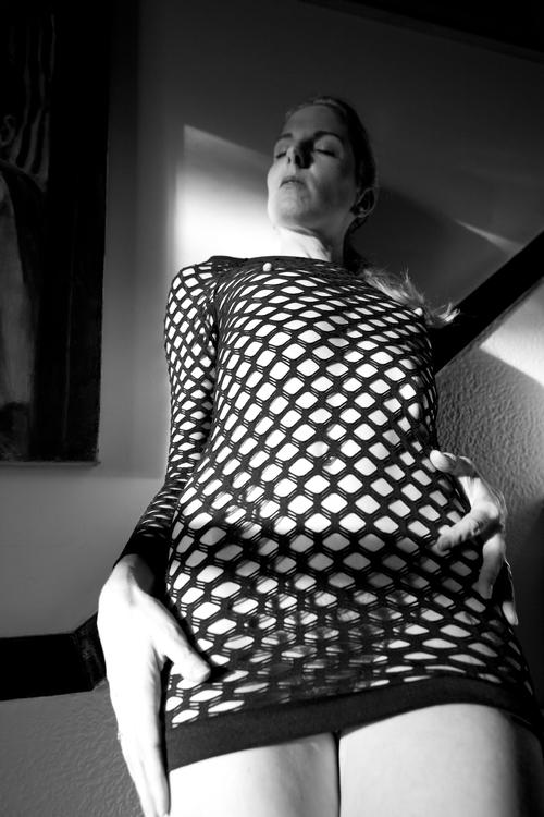 New Fishnet Dress Fishnet dresses are always interesting. They reveal so little and yet show so much. These are my latest