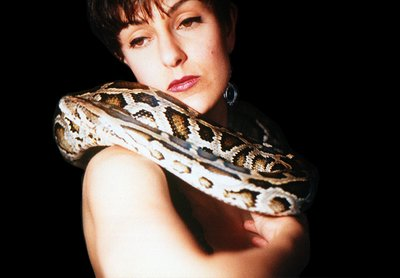 Virginia and Slash slide portrait of girl with Burmese python