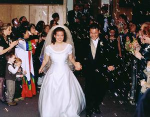 Candid Wedding Image Bride and Groom leaving reception; Columbine Country Club.