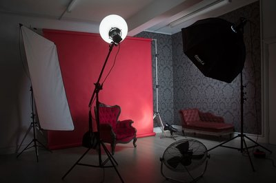 Cherry backdrop setup Here is our cherry backdrop from Creativity International with large globe diffuser, large softbox, a boudoir chair, chaise, our dark damask paper corner and a wind machine.