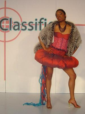 """Designs by Theodore Elyett Fashion Designer: Theodore Elyett~~Fashion Show:""""CLASSIFIED: Weapons of Mass Seduction 2005"""" ~~Photographer: Mihkel Fortney Photography~~Hair: Judy Inc.~~Make-up: Industry Cosmetics~~Model: Michelle Harris - T.E.S.Models"""