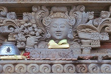 Detail of temple building in Bali Stone carving on outside of structure