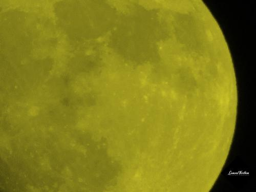 Colorizing The Moon Yellow If it was actually made of nacho cheese sauce.