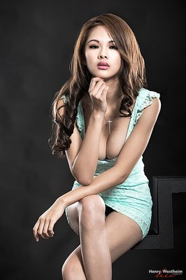 Sexy Portrait of a beautiful young Asian woman in studio