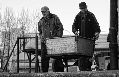 job Two workers during their jobs on local market somewhere in  east europe