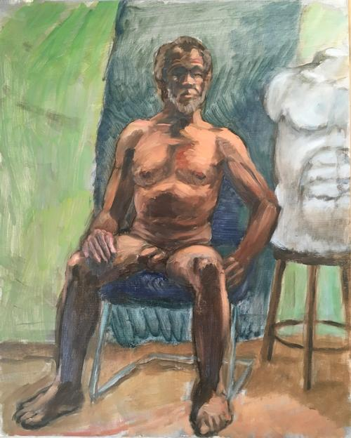 Seated nude man with cast of torso